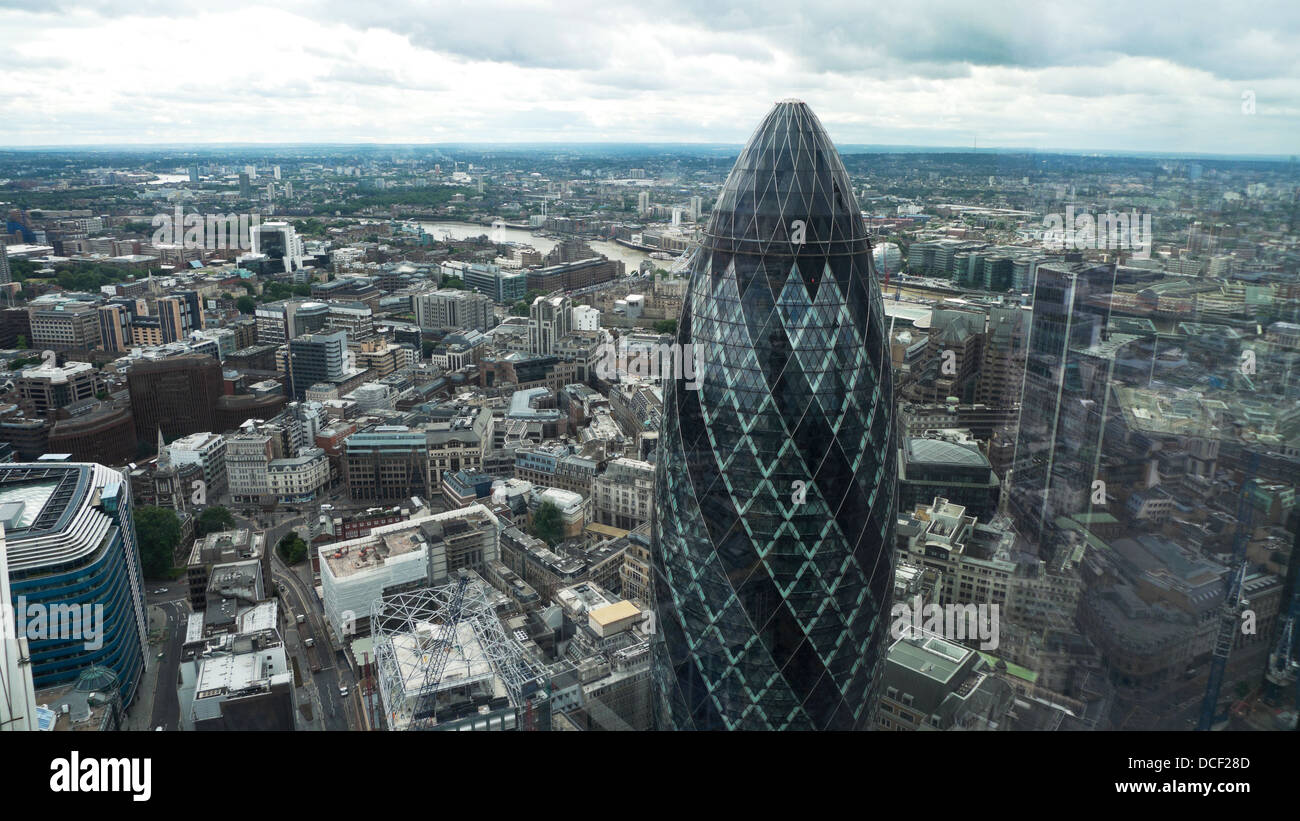 An aerial view over City of London and 30 St Mary Axe looking south and east from the Heron tower high rise building - Stock Image