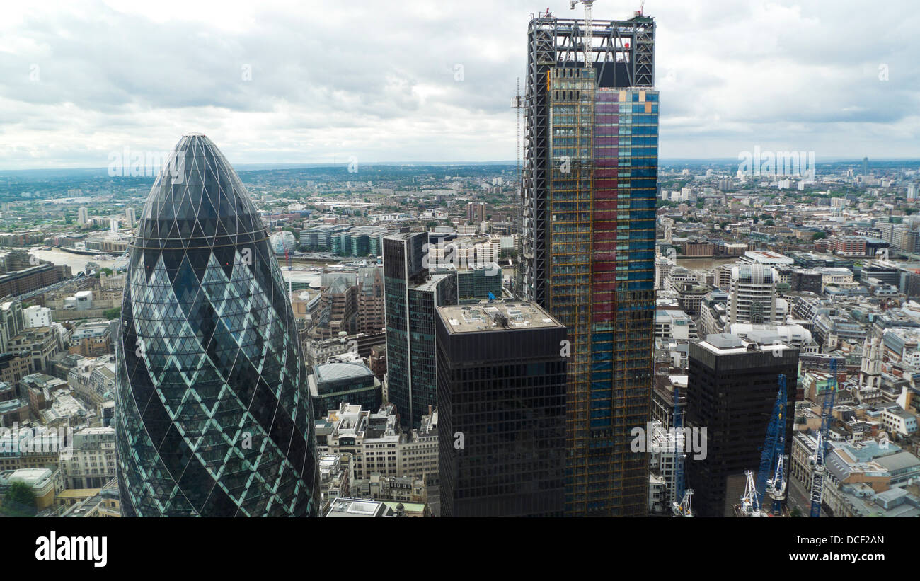 Aerial high view looking south over London of the 122 Leadenhall St building the Cheesegrater and the Gherkin in Stock Photo