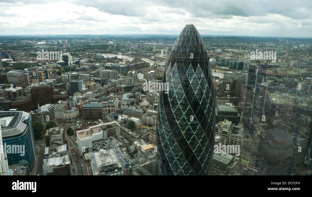 London skyline high aerial view looking south east over the gherkin building at 30 St Mary Axe City of London UK Stock Photo