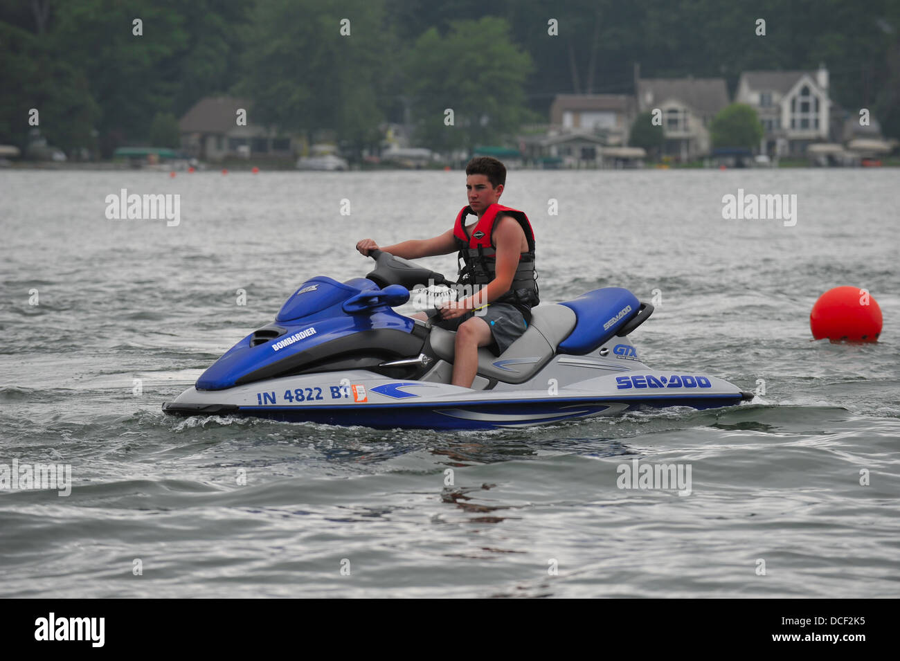 Male teen on a personal watercraft. - Stock Image