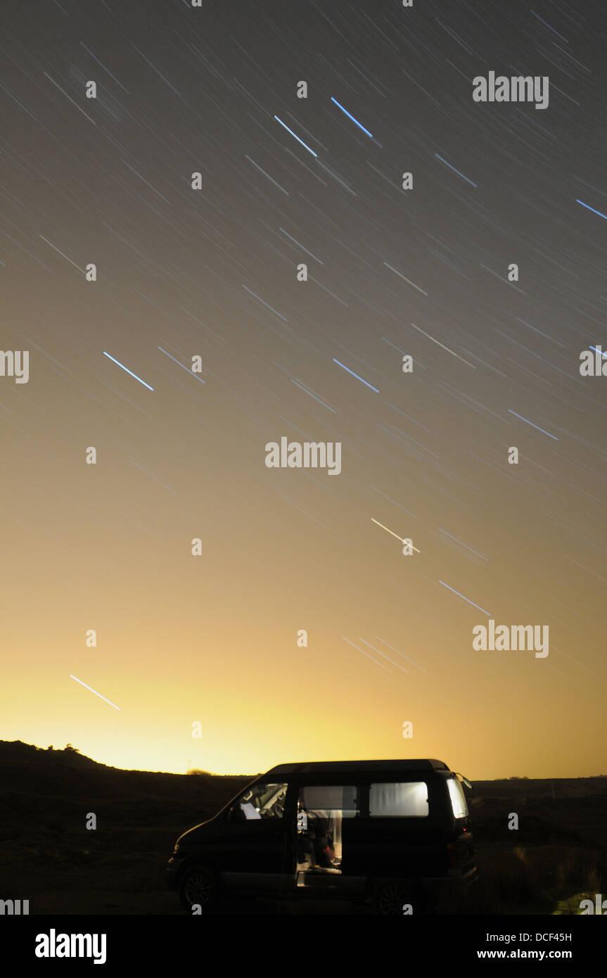 Stars circle a camper van at Cadover Bridge , Plymouth ,Devon,UK - Stock Image