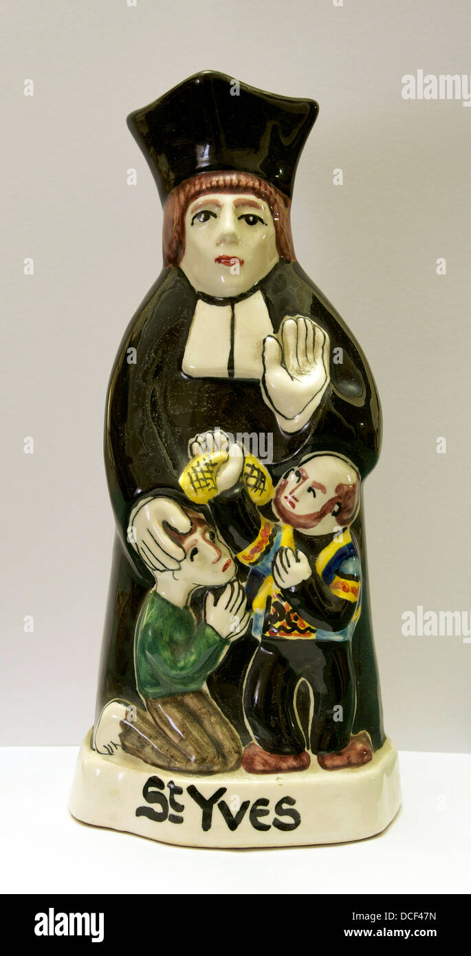 Statuette of Saint Ives (Ivo of Kermartin), patron saint of Brittany and of lawyers. He defends the poor man, and - Stock Image