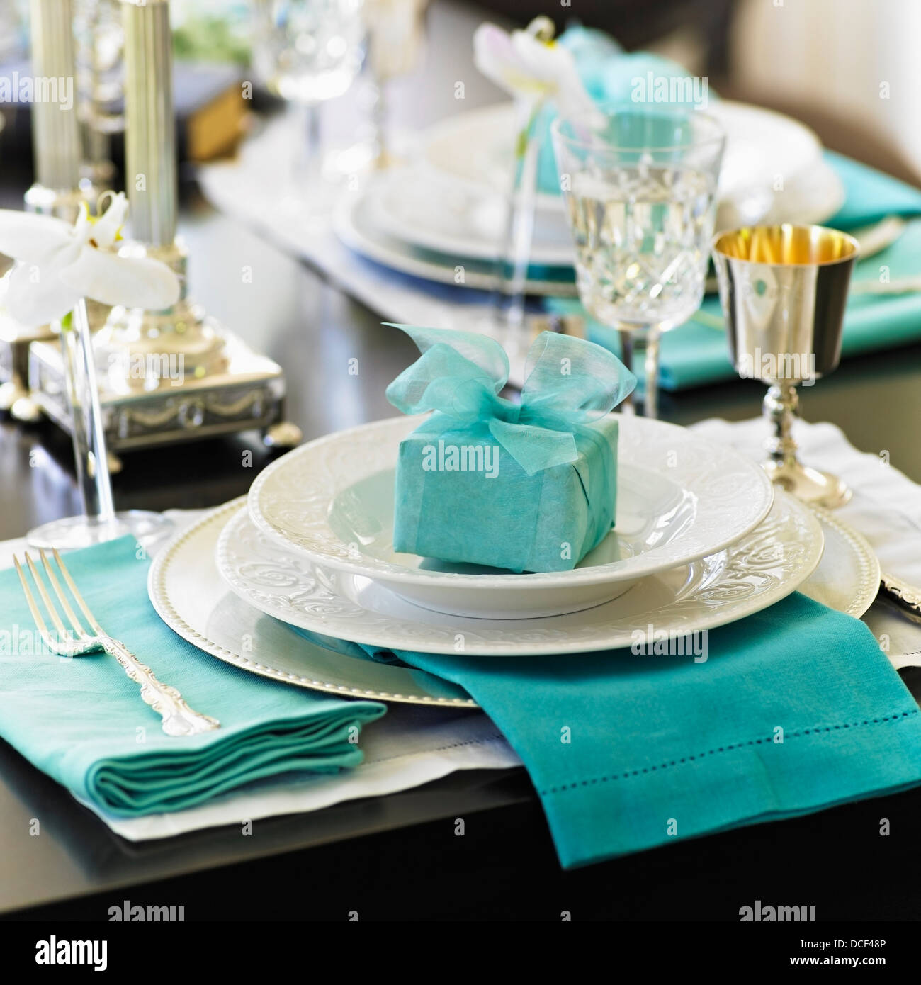 Formal table setting with white dishes and blue gift and napkins;Victoria vancouver island british columbia canada & Formal table setting with white dishes and blue gift and Stock Photo ...