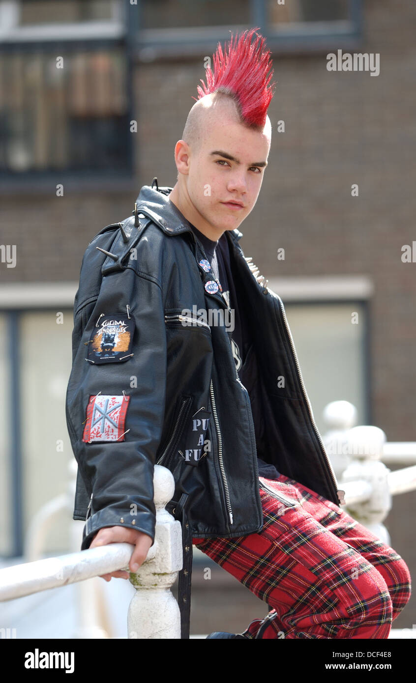 Punk boy with a red mohawk hairstyle - Stock Image