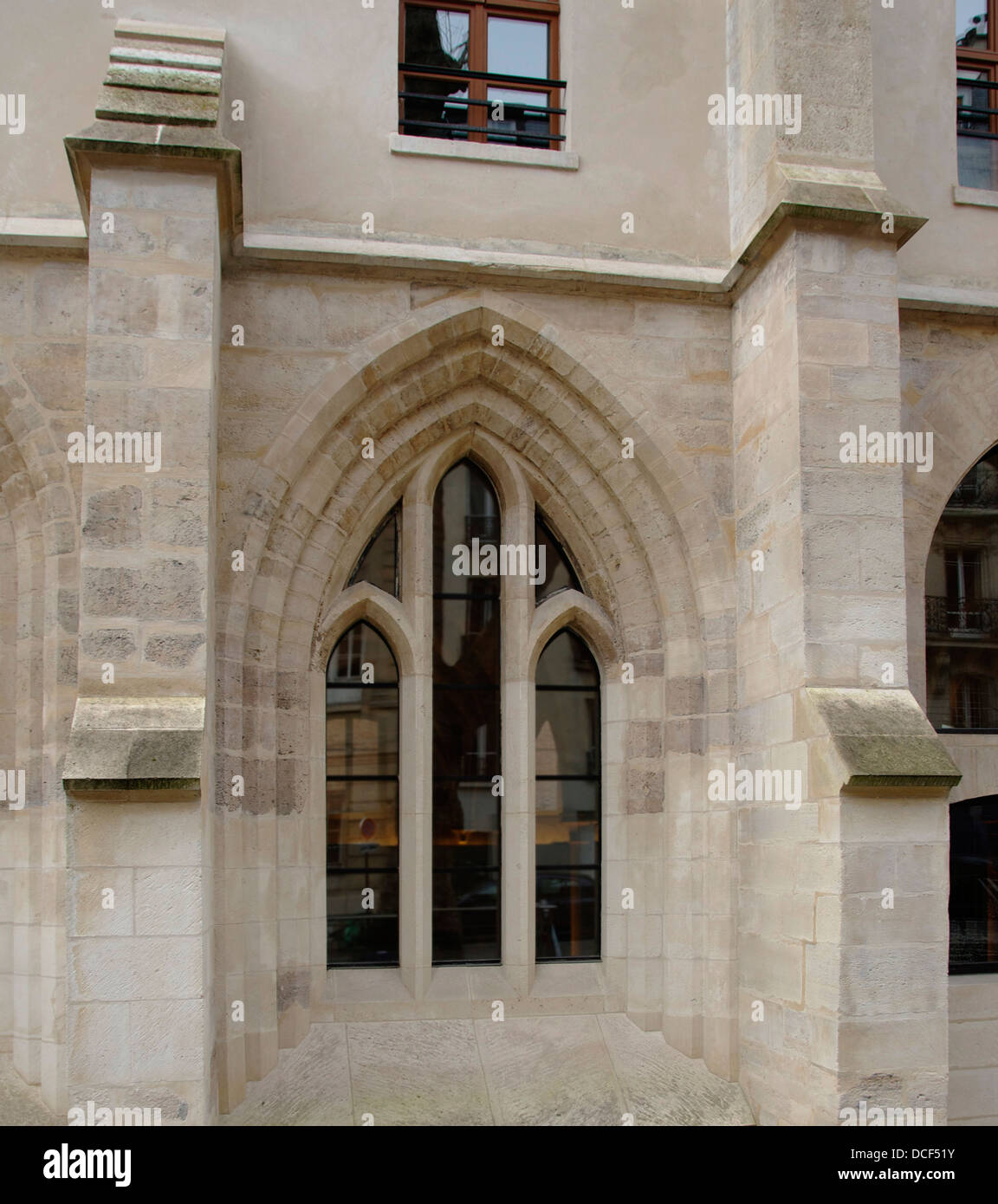 A gothic (13th century) trifora window, 'Collège des Bernardins', Paris. - Stock Image