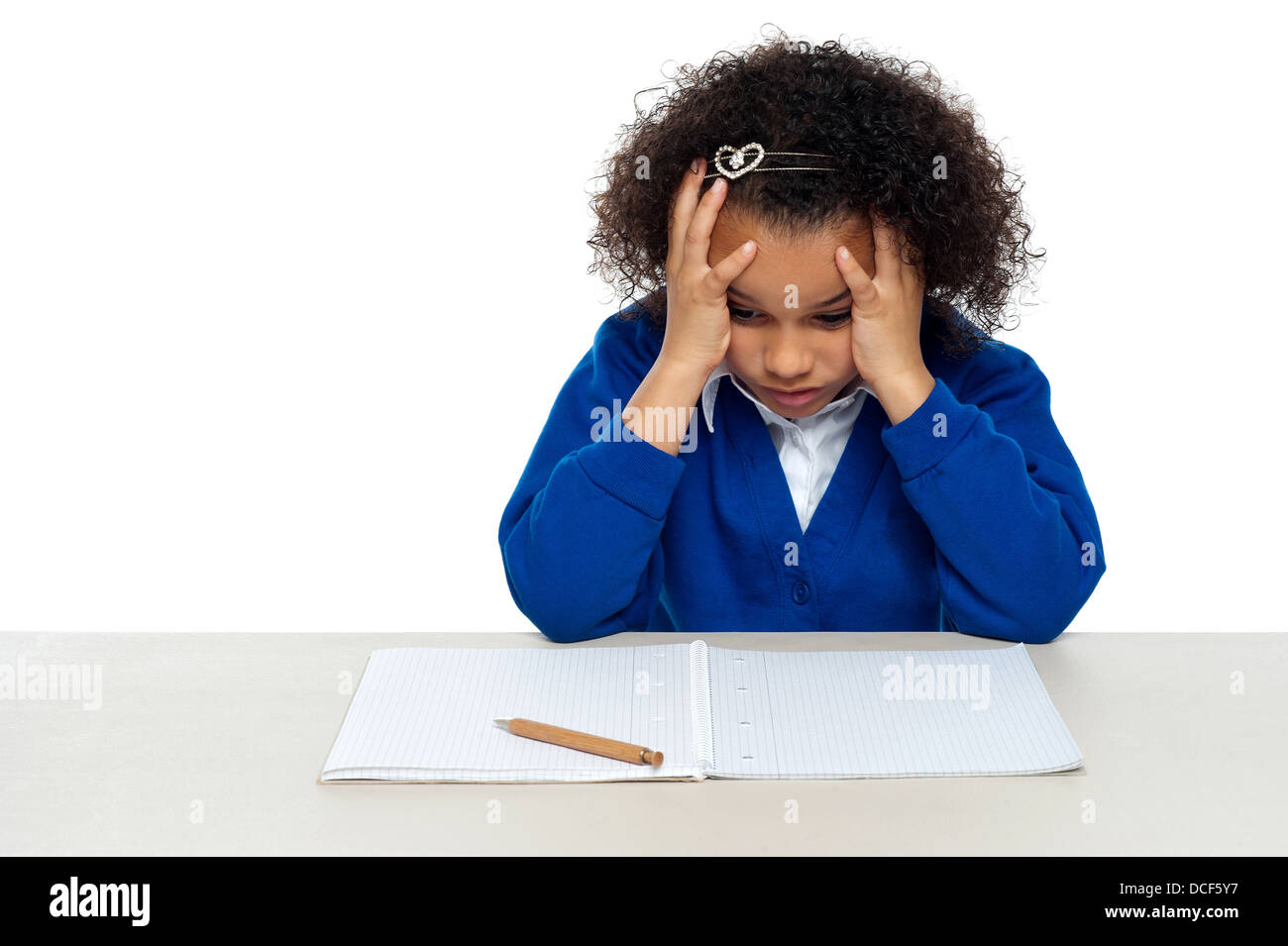 Stressed out primary girl child thinking hard to recollect the answer - Stock Image