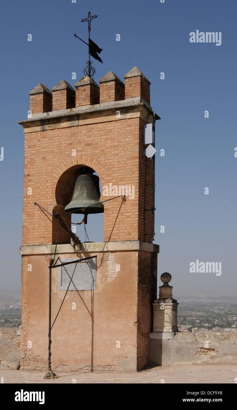The bell gable at the top of the Torre de la Vela in Alcazaba, Alhambra de Granada, Spain - Stock Image