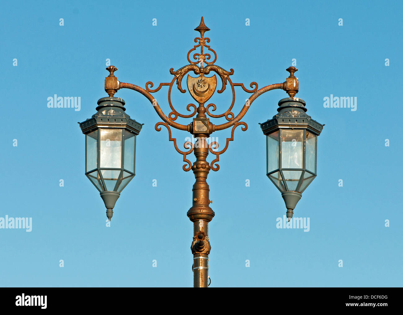 Ornate lamps on post - Stock Image