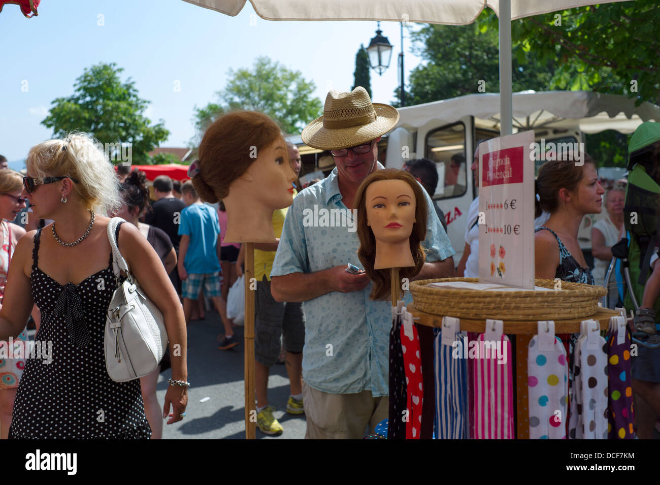 A stall holder selling Accessories  for the Chignon hairstyle - Stock Image