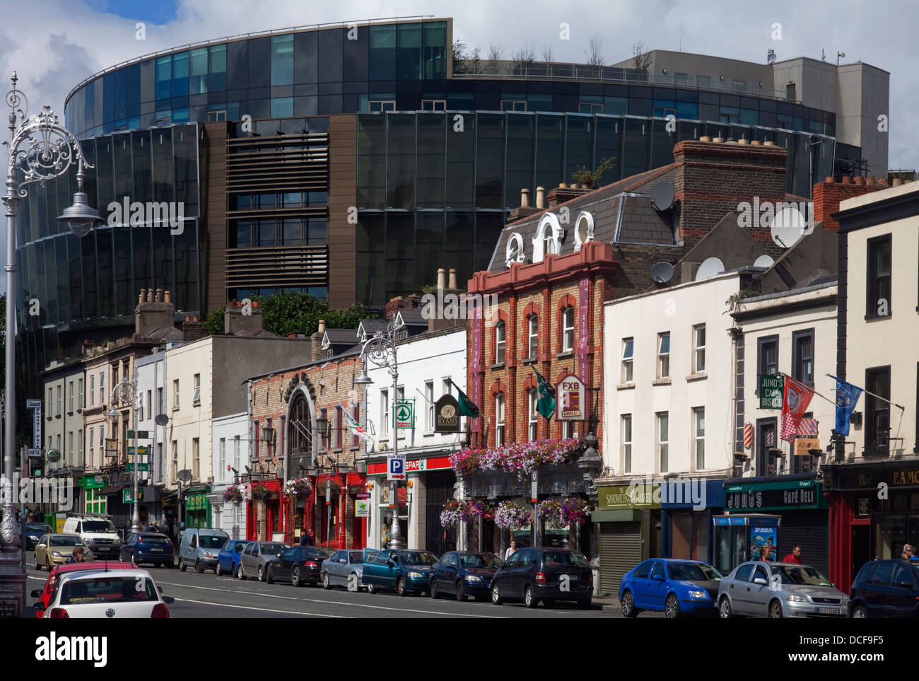 Shops and Pubs on Pargate Street, dwarfed by the new Criminal Courts of Justice, Near the Phoenix Park, Dublin City, - Stock Image