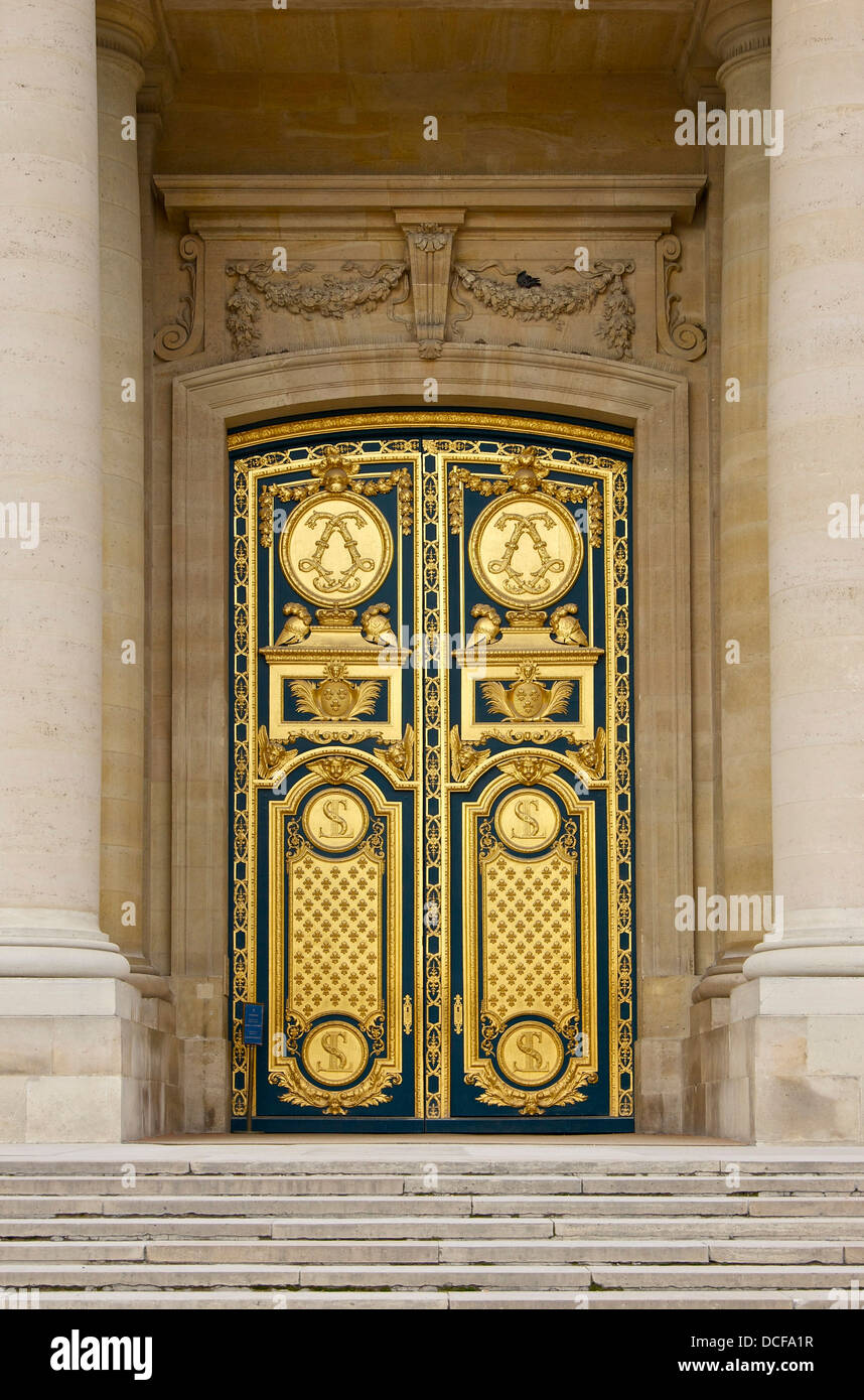 Golden bronze gate of Cathedral Saint-Louis des Invalides in Paris (access to the dome) - Stock Image