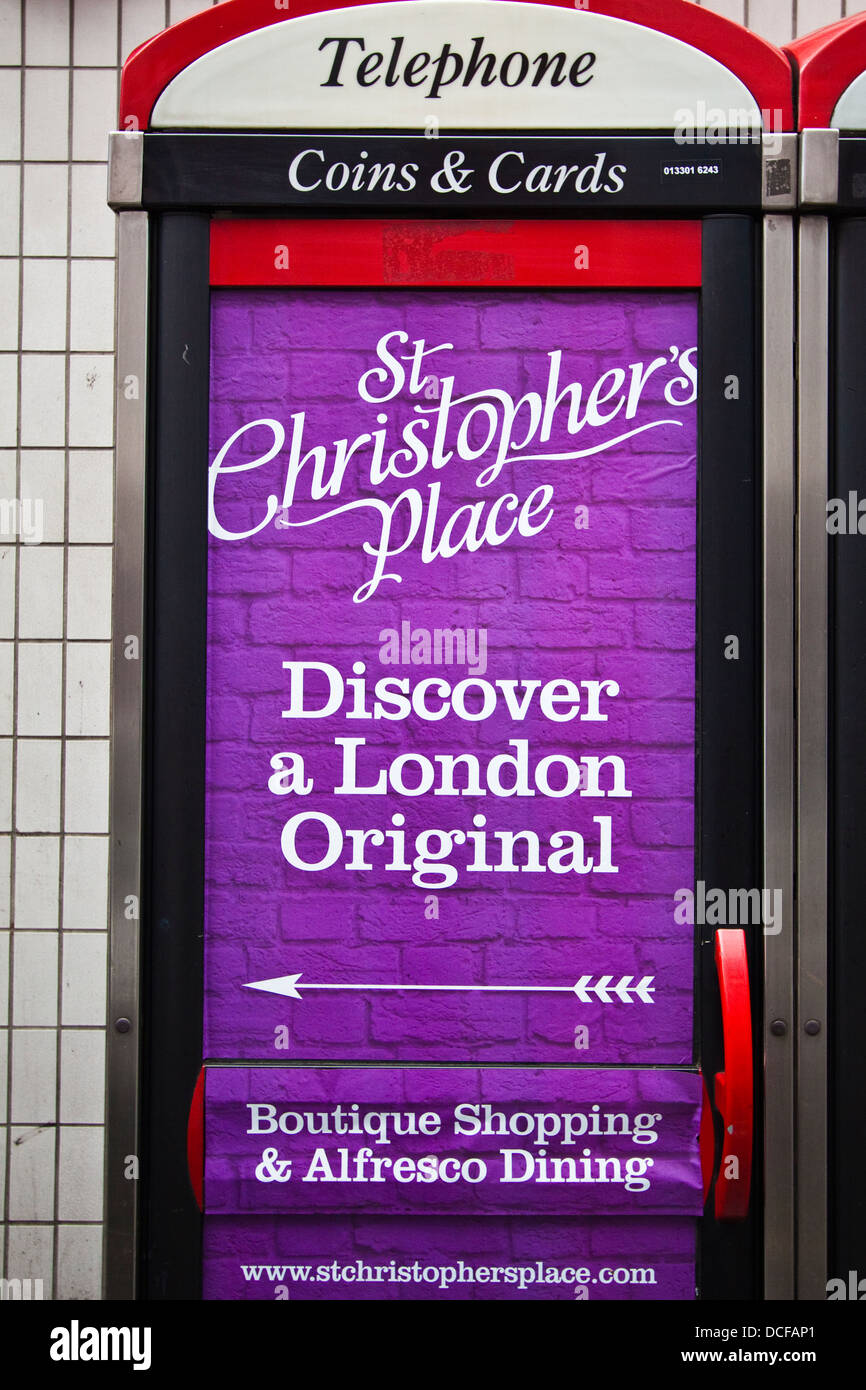 St.Christophers Place advert on the side of telephone kiosk, London - Stock Image