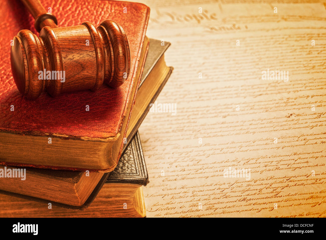 Gavel and Constitution American Justice Concept - gavel, a pile of books, and a copy of the American Constitution. - Stock Image