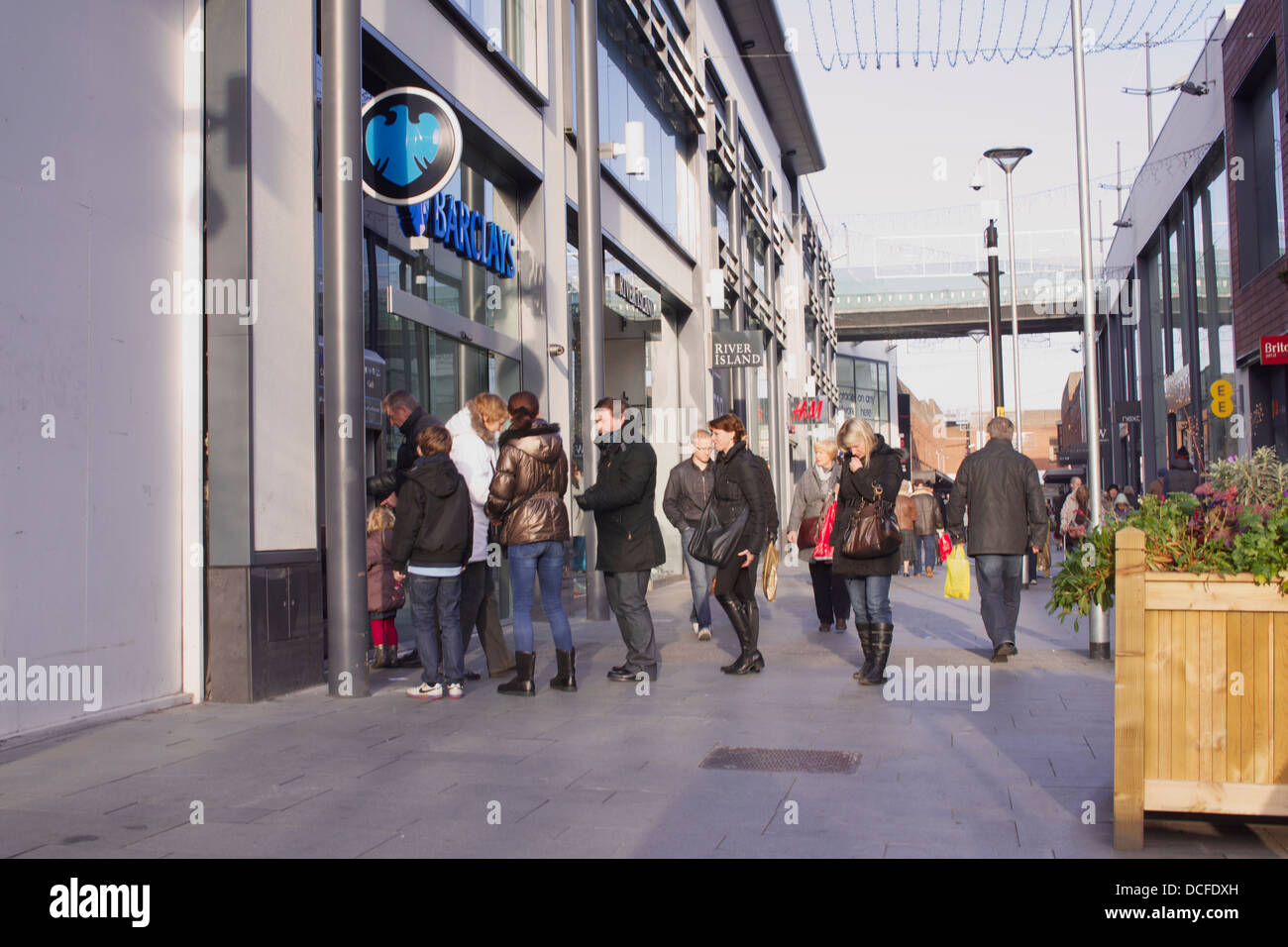 Queuing for the cash point - Stock Image