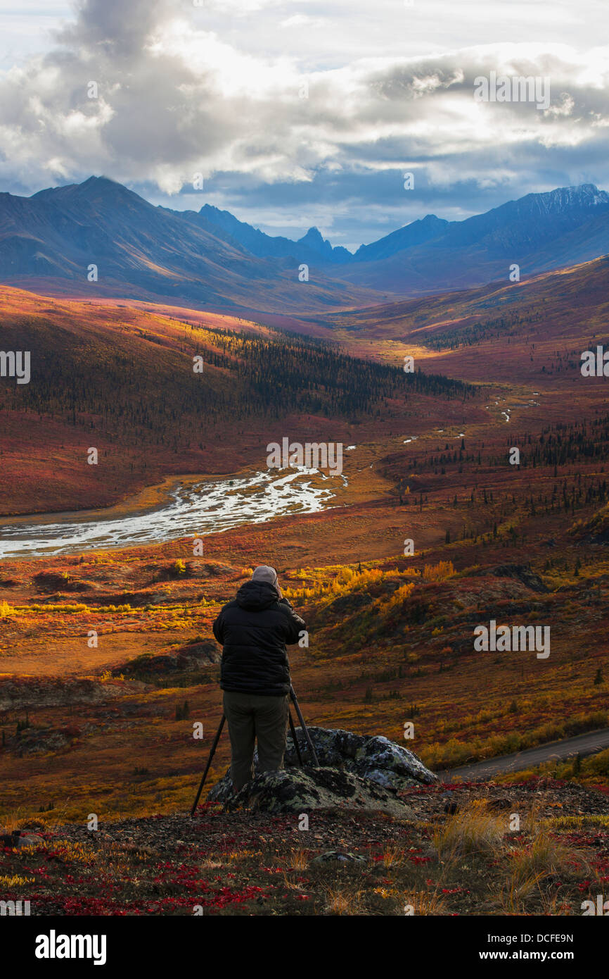 Person Photographing The Colors Of Autumn Over Klondike Valley In Tombstone Territorial Park;Yukon Canada - Stock Image