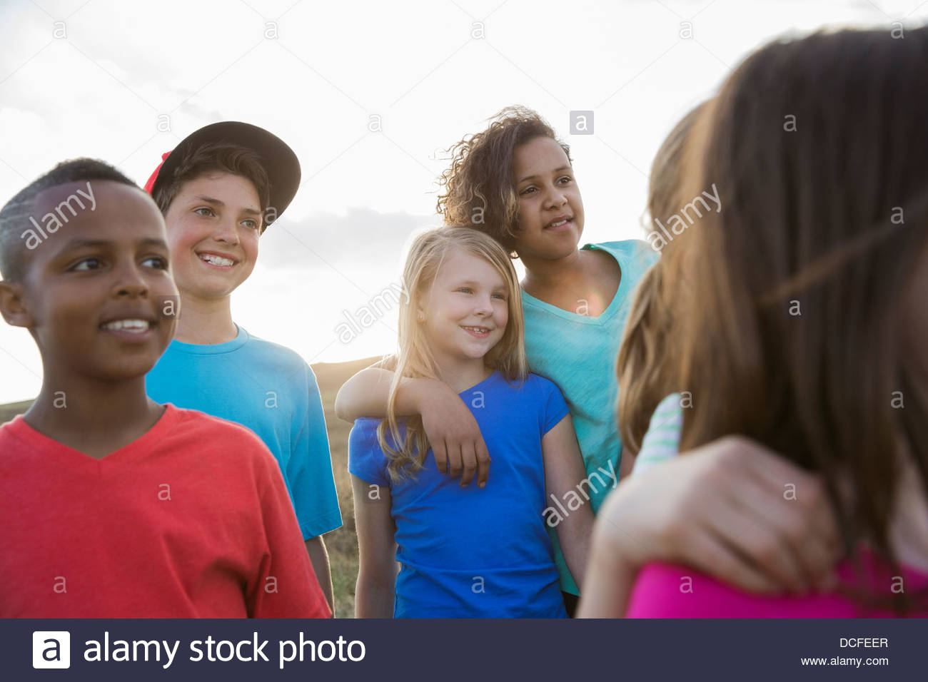Group of kids standing together outdoors - Stock Image