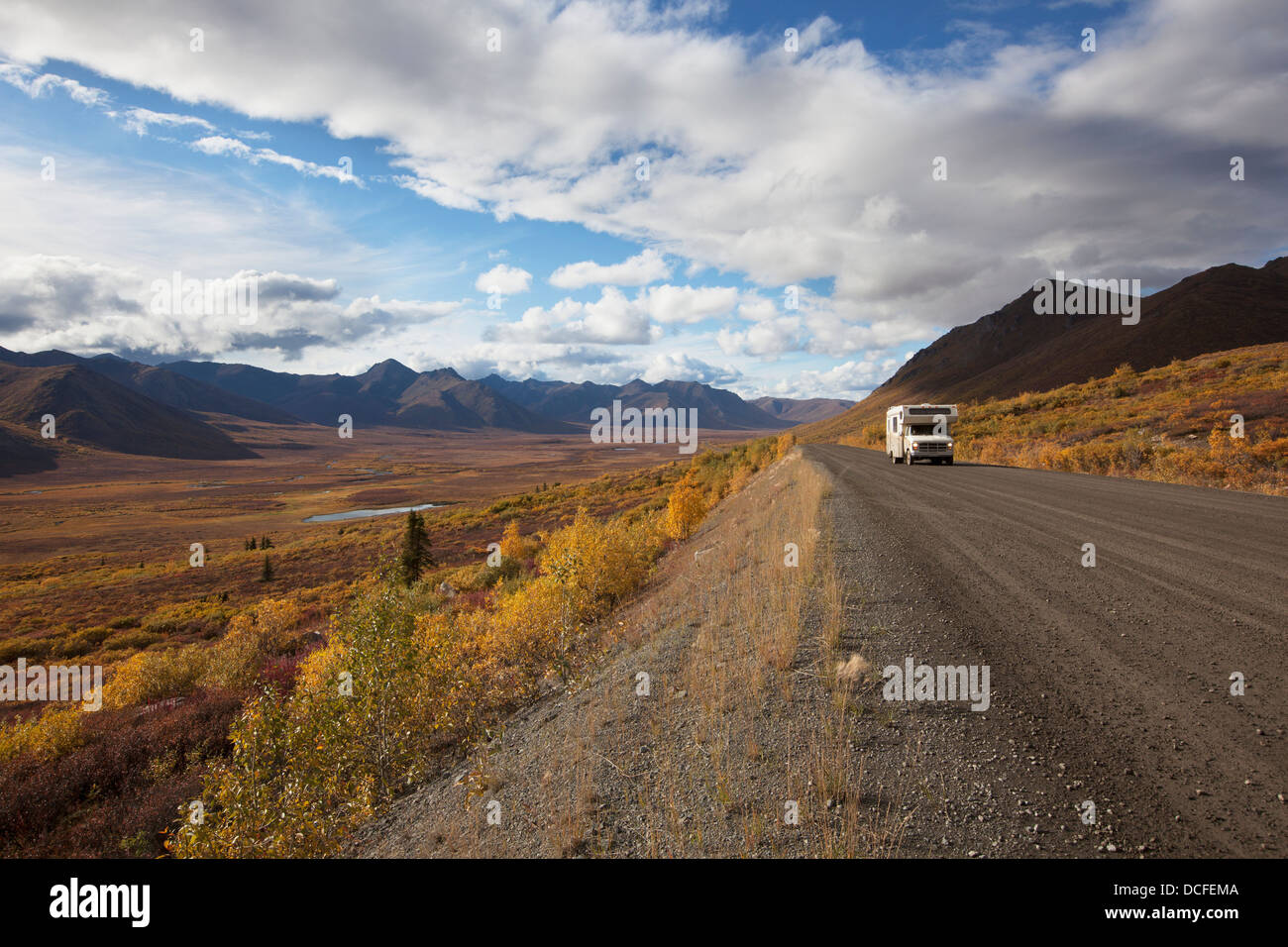A Recreational Vehicle Drives On Dempster Highway Past Klondike Valley In Tombstone Territorial Park;Yukon Canada - Stock Image