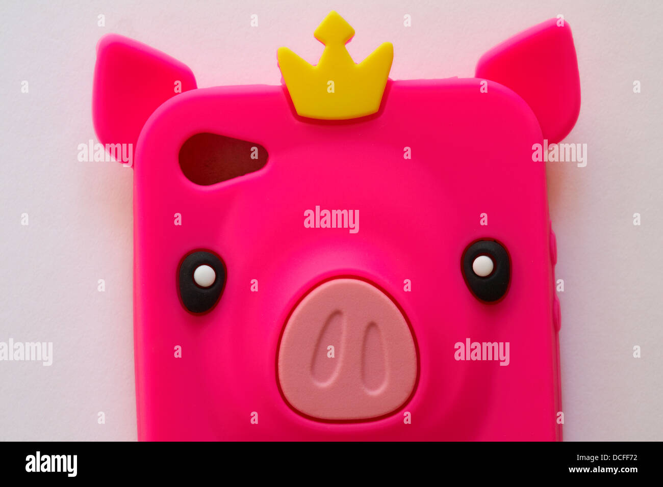 top of pink pig mobile phone cover case set on white background - Stock Image