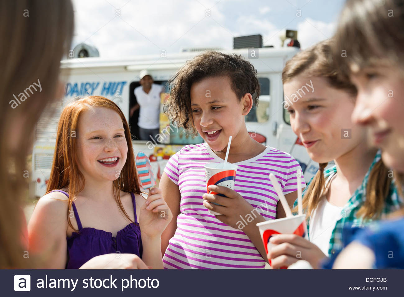 Group of kids eating ice cream outside - Stock Image