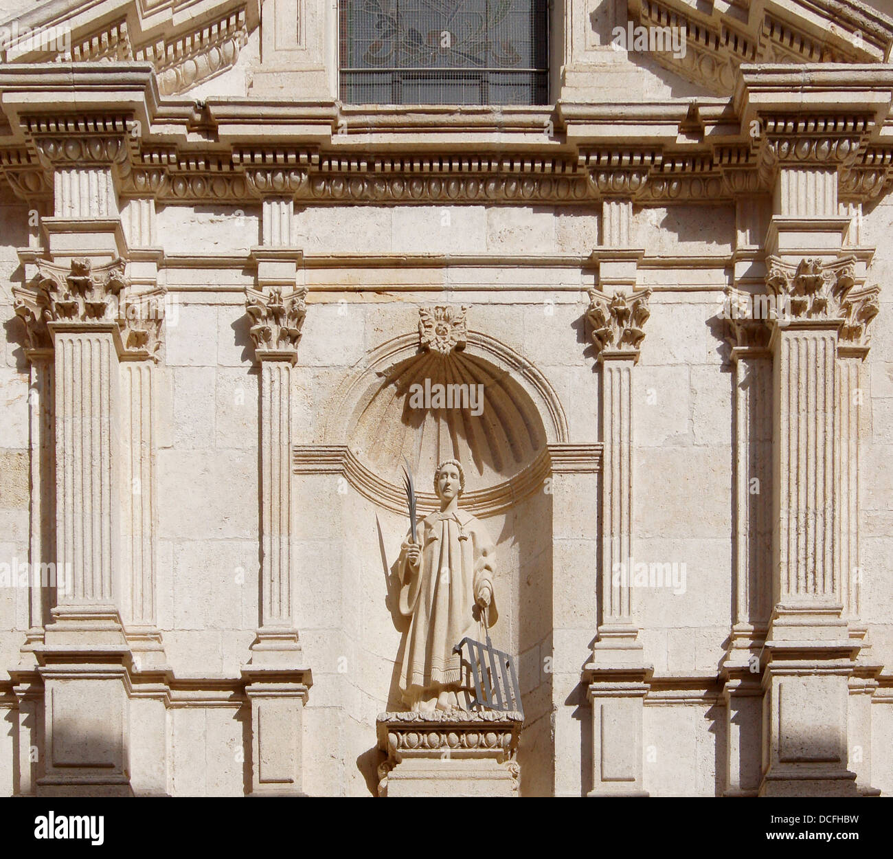 partial view of the baroque façade of church San Lorenzo in Burgos, Spain, with the statue of the saint. - Stock Image