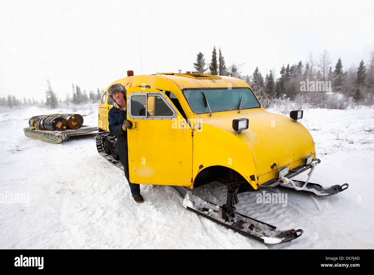 Man With Snow Sled In Wapusk National Park; Churchill, Manitoba, Canada - Stock Image