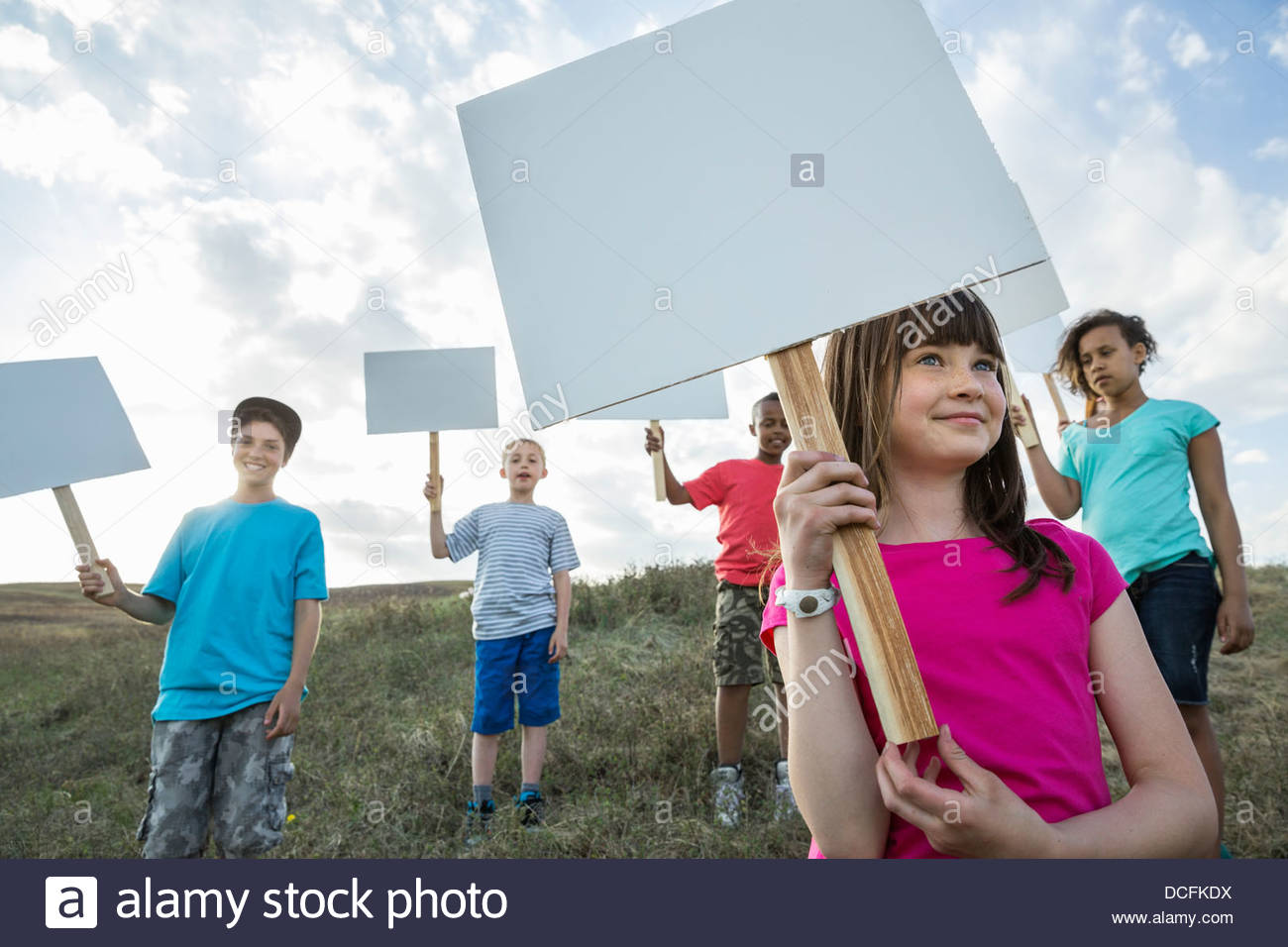 Group of kids holding blank sign boards - Stock Image