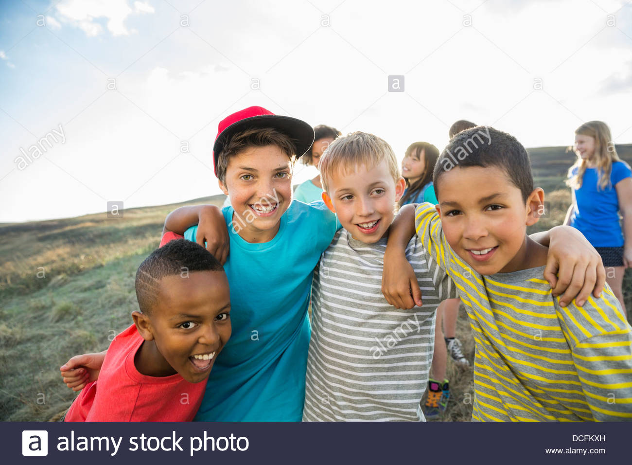 Group portrait of boys with arms around each other - Stock Image