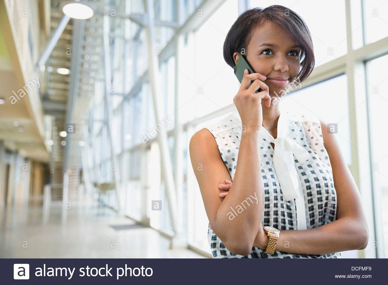 Business woman using smart phone - Stock Image