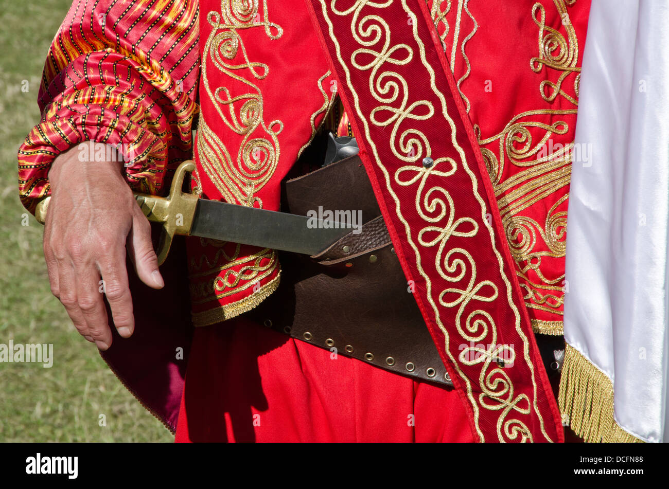 Turkish Man In Traditional Ottoman Dressed Outfit Holding Knife