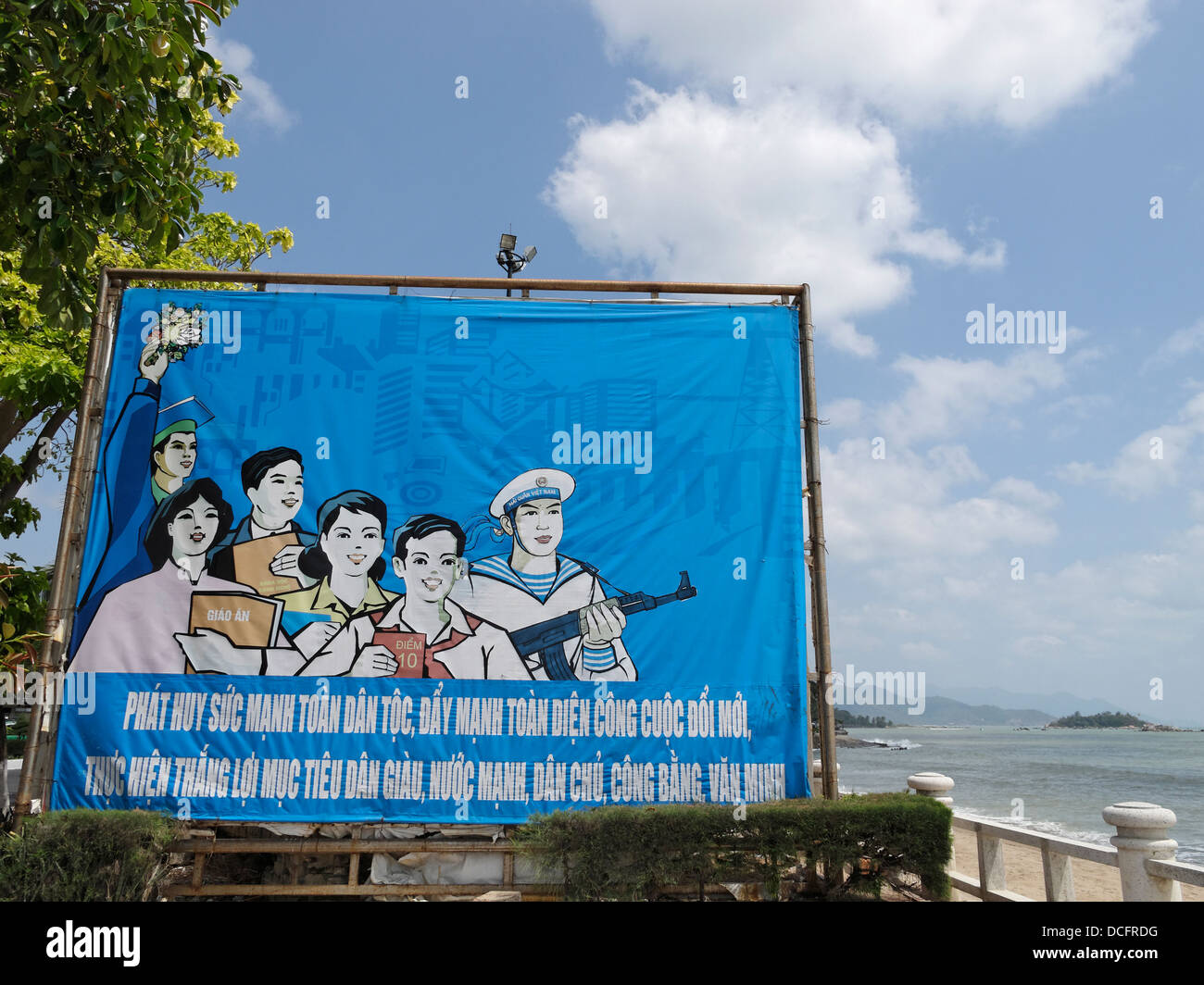 A propaganda poster next to the beach in Nha Trang, Vietnam. - Stock Image