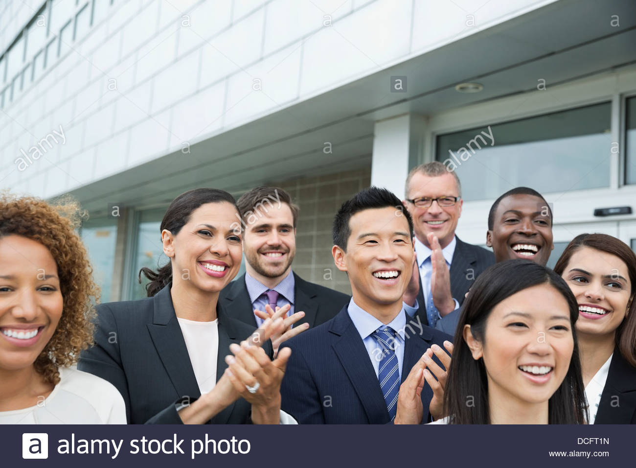 Group of business people clapping - Stock Image