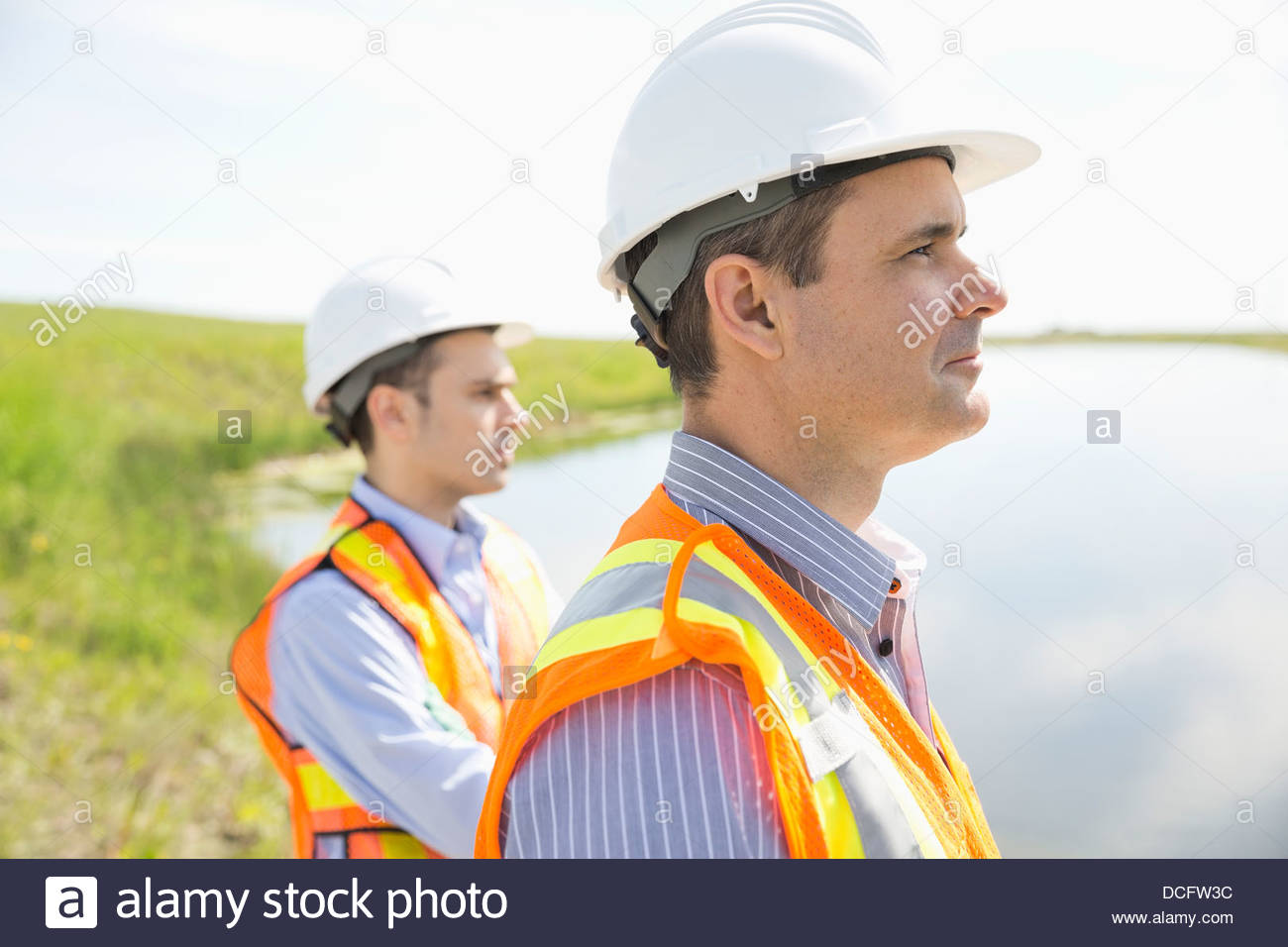 Ecologists looking at river - Stock Image