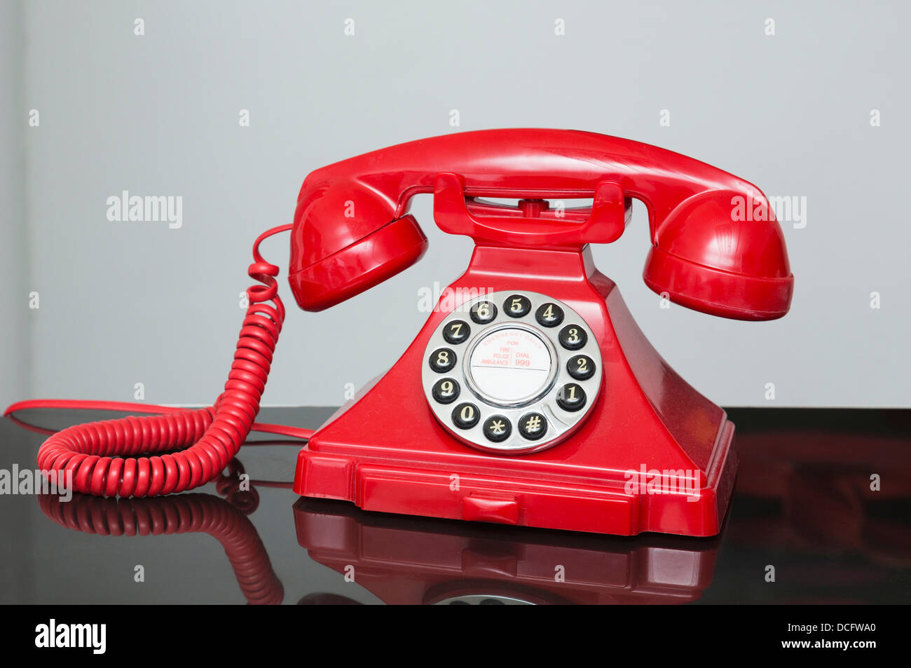 red retro / vintage style telephone of the 1930s-1940s era - Stock Image