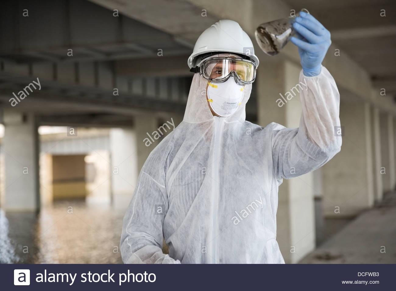 Technician examining contaminated water - Stock Image