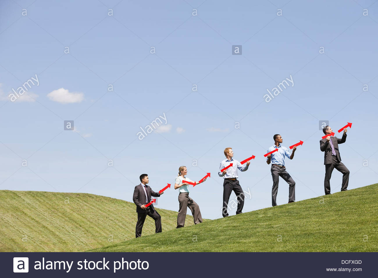 Group of businesspeople implying success - Stock Image