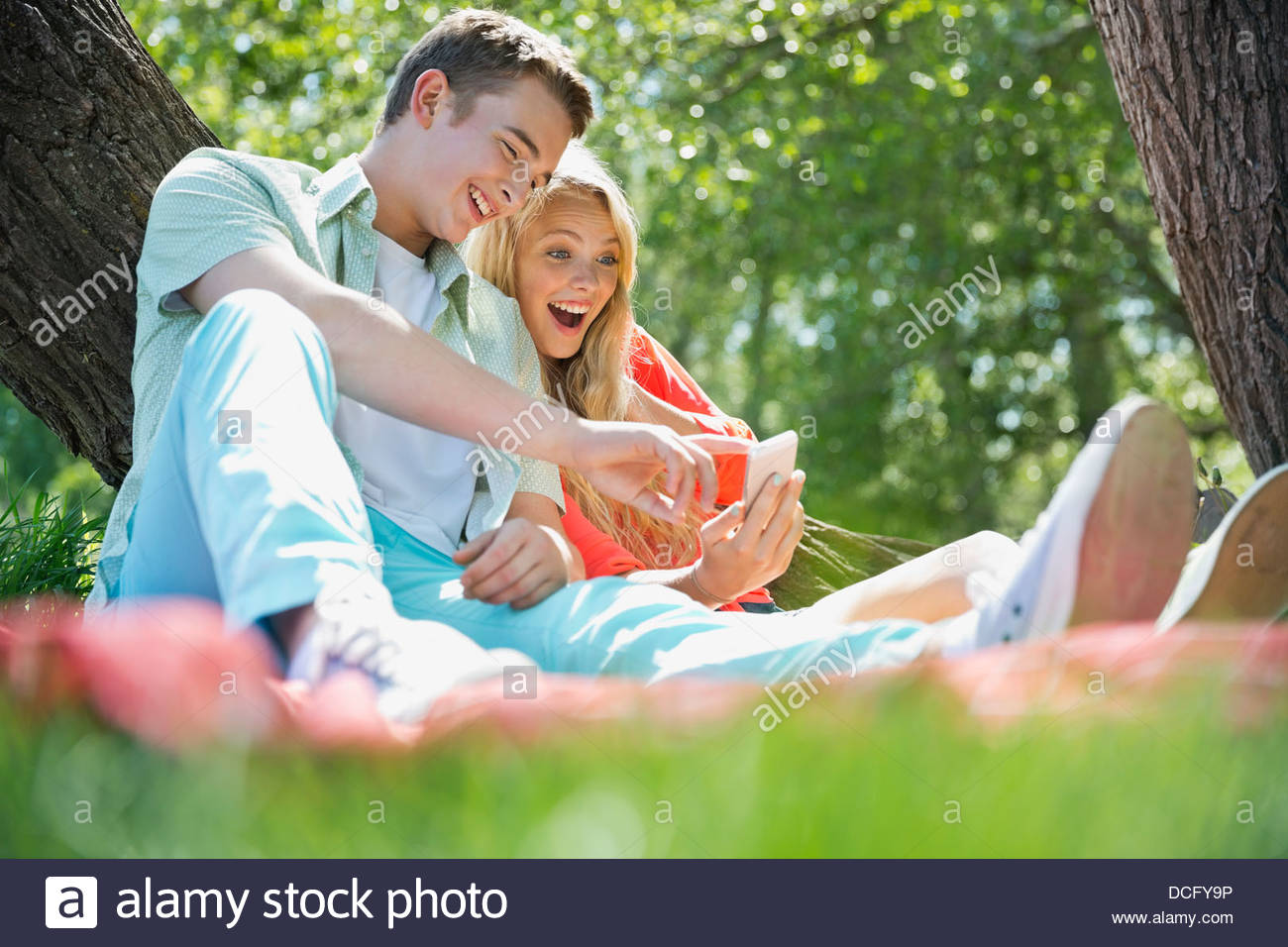Teenagers using smart phone - Stock Image