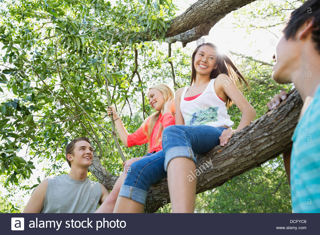 Teens spending time together outdoors - Stock Image