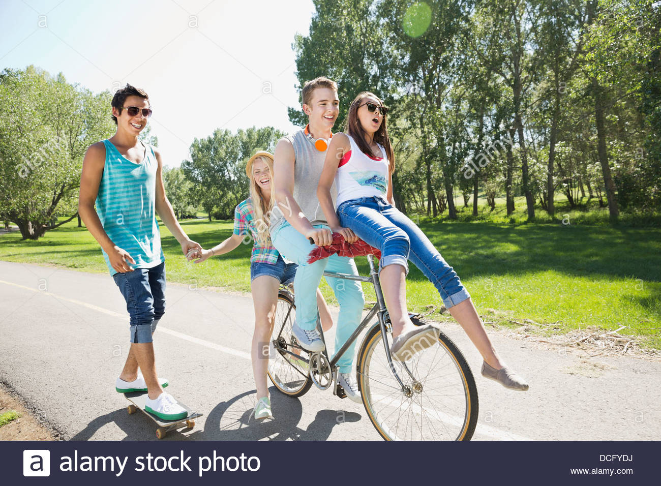 Teenagers hanging out in a park - Stock Image