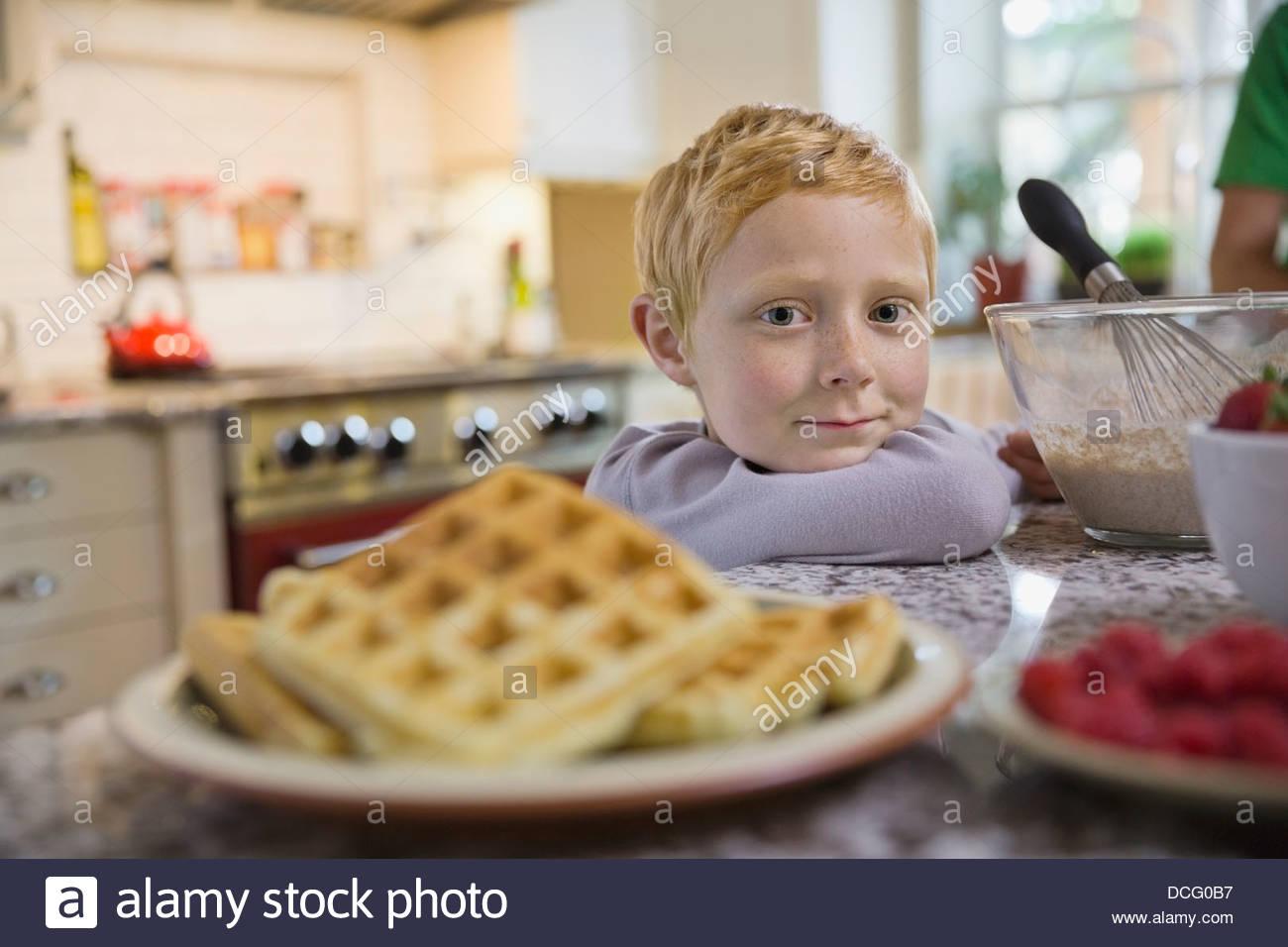 Portrait of little boy with breakfast - Stock Image