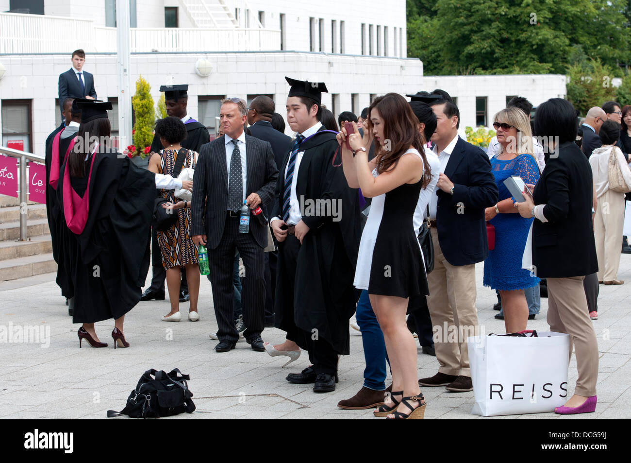Warwick University graduation day, graduates with friends and families. - Stock Image