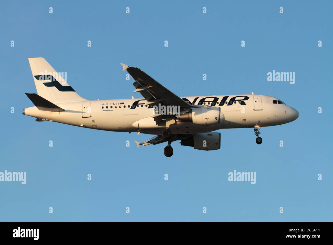 Commercial air travel. Finnair Airbus A319 passenger jet aeroplane on approach - Stock Image