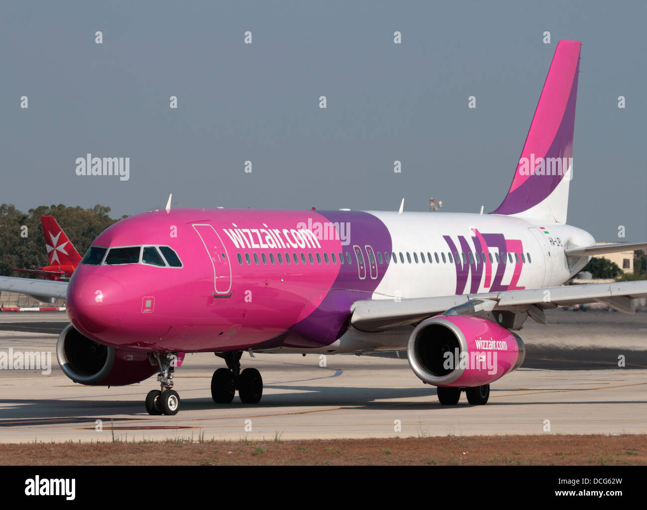 Airbus A320 jet plane belonging to the Hungarian low cost airline Wizz Air taxiing for departure from Malta - Stock Image