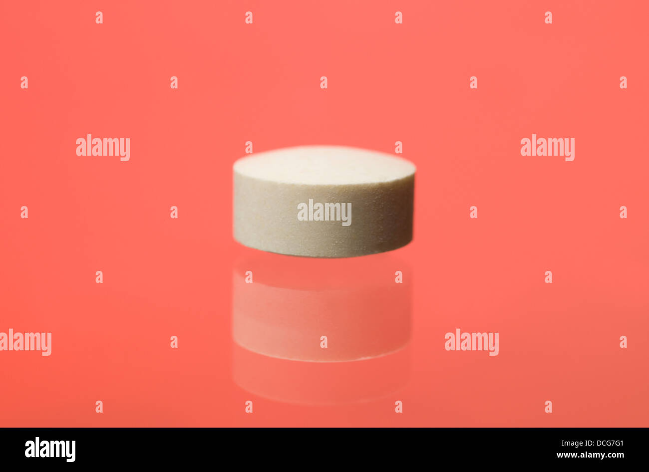 Pill toward red background - Stock Image