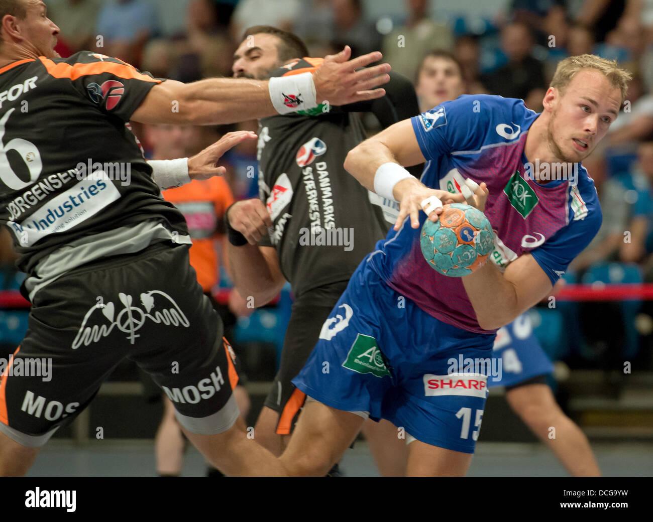 Hamburg, Germany. 16th Aug, 2013. Hamburg's Henrik Toft Hansen (R) in action against Kolding's Lars Jorgensen - Stock Image