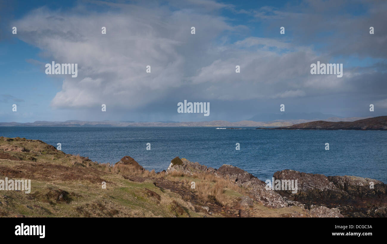 Dramatic rain clouds passing over Enard Bay on the north west coast of Scotland, UK - Stock Image