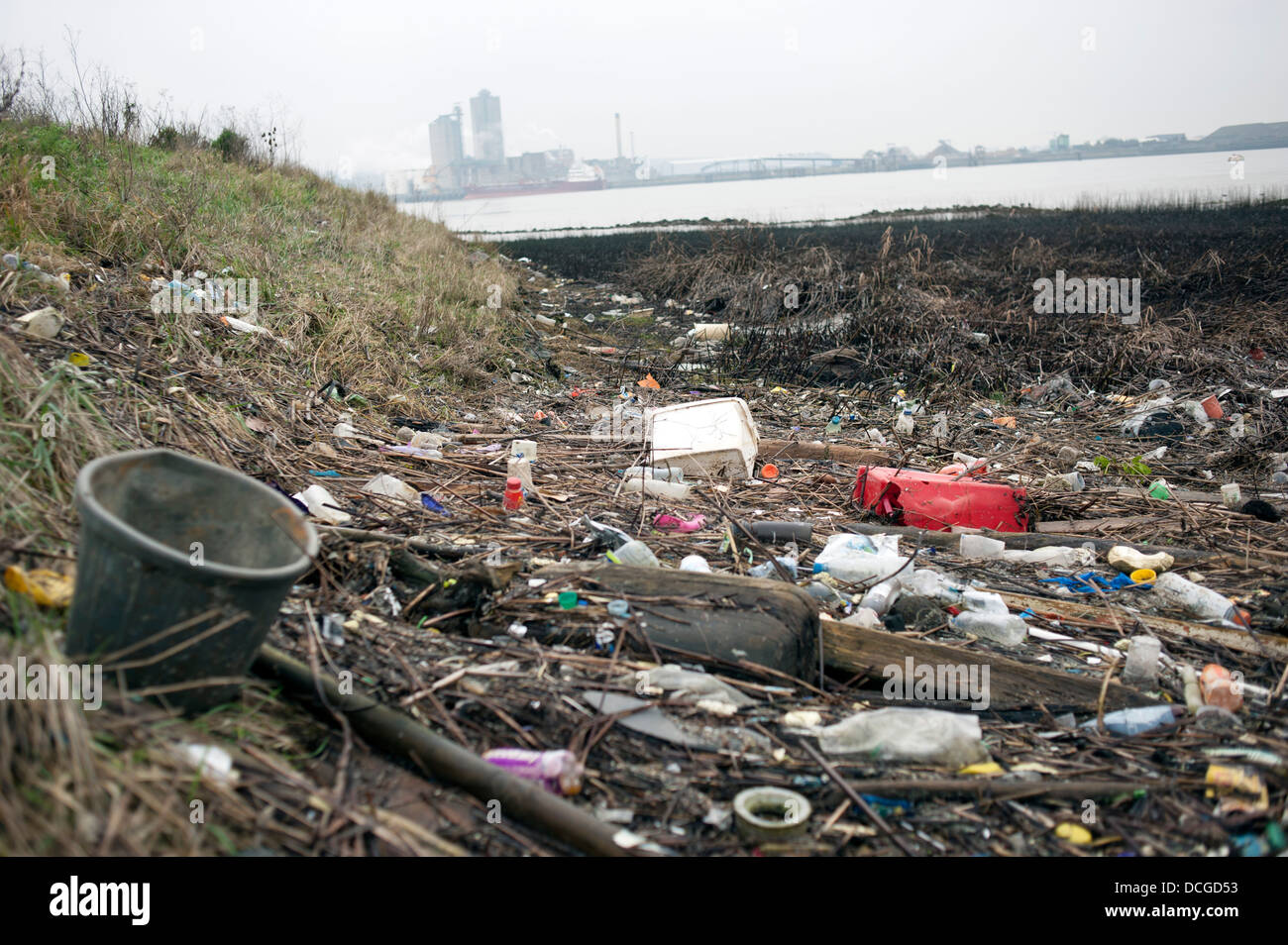 Rubbish is pictured on the shore of the River Thames near Rainham Landfill Site in Essex - Stock Image