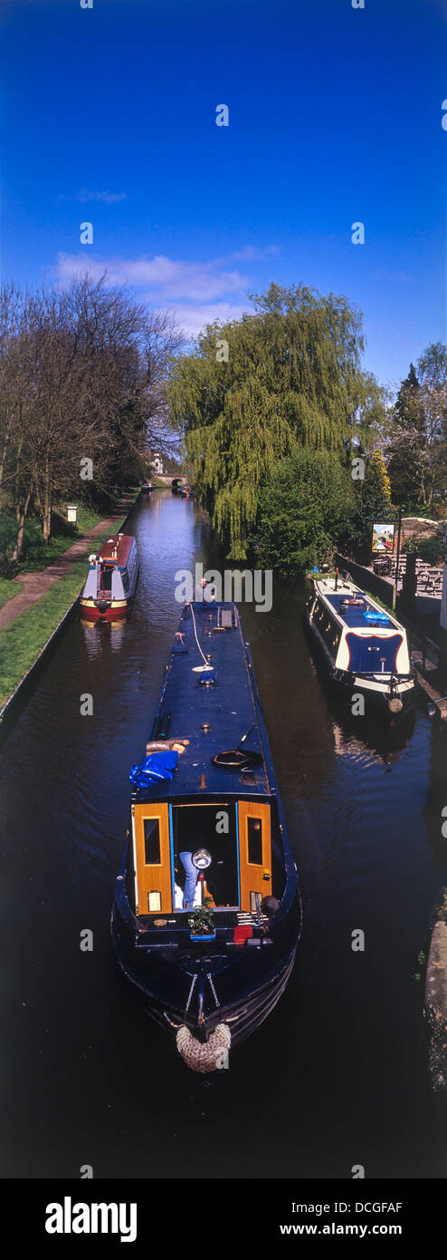 A narrowboat passing The Boat Inn on the Shropshire Union Canal. - Stock Image