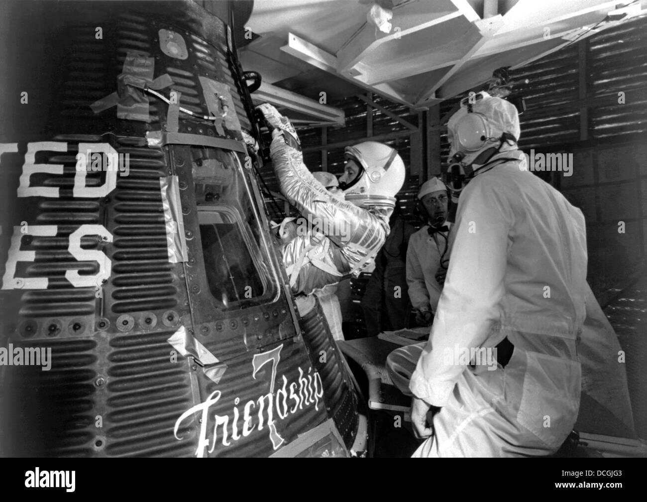 Digitally restored photo of astronaut John Glenn entering the Friendship 7 spacecraft. - Stock Image