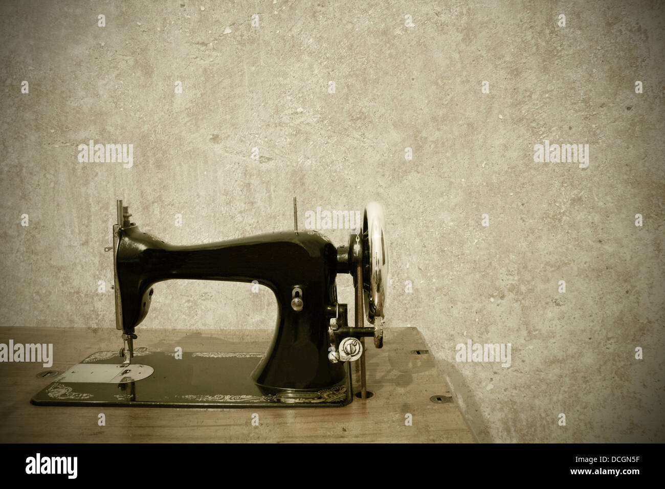 a very old sewing machine on a white background - Stock Image