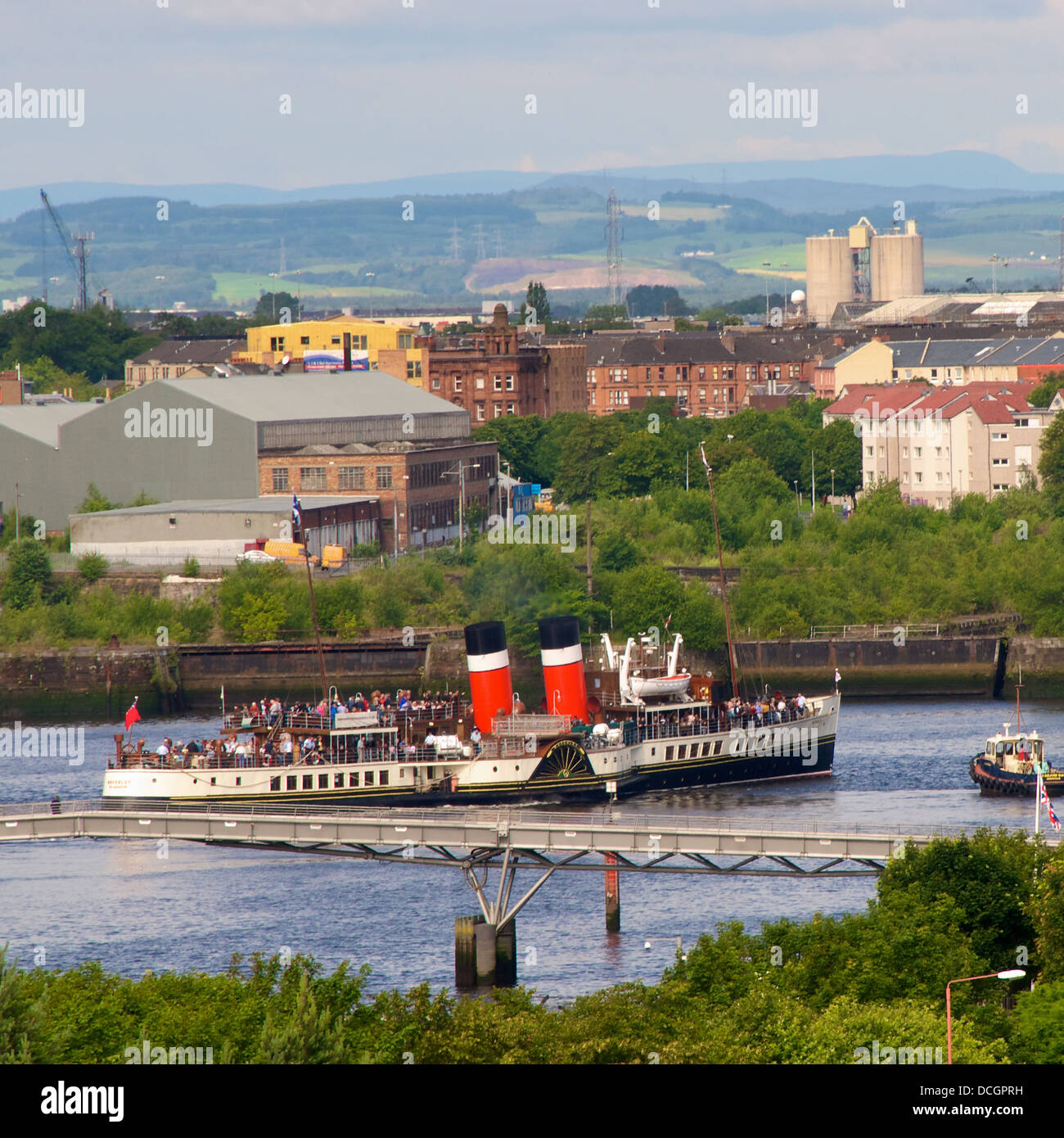Waverley sailing down the Clyde in centre of Glasgow, Scotland on its regular cruises during the summer months - Stock Image